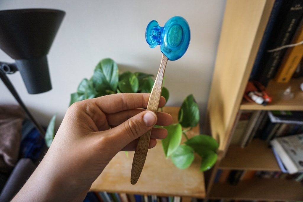 Bamboo toothbrush with a sanitizer cover