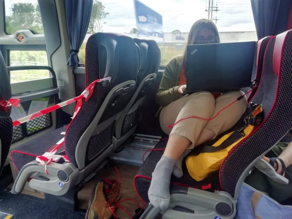 me working on a bus to Paris