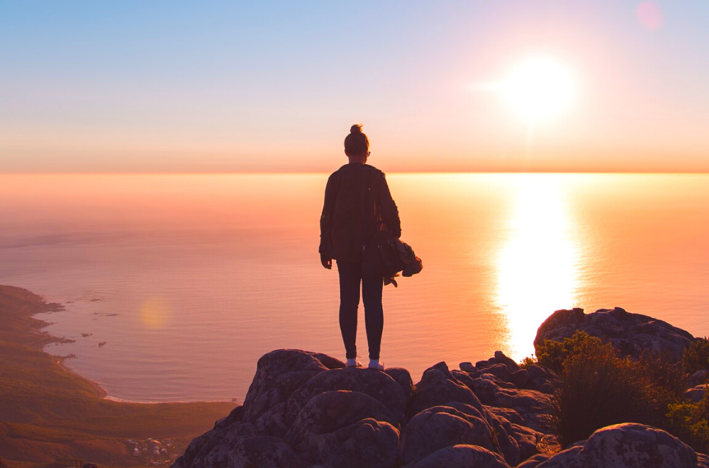 Woman looking at the horizon to see what the future holds